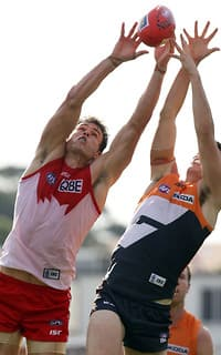 Swans ruckman Mike Pyke stretches for a mark against the Giants