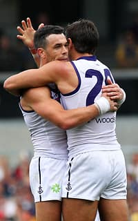 Ryan Crowley and Matthew Pavlich celebrate during Freo's win