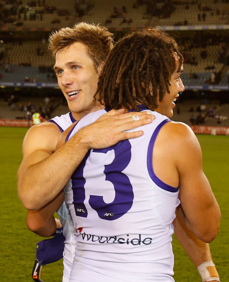Matt de Boer and Tendai Mzungu of the Dockers celebrate their win in the 2013 AFL Round 19 match between the Carlton Blues and the Fremantle Dockers at Etihad Stadium, Melbourne on August 03, 2013. (Photo: Lachlan Cunningham/AFL Media)