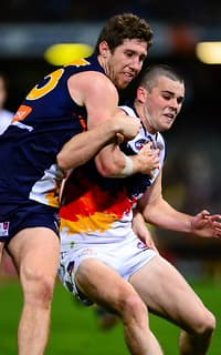 Eagle Patrick McGinnity and Crow Brad Crouch in action on Saturday night