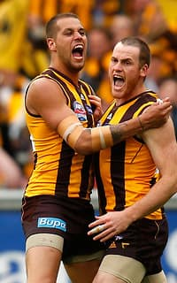 Lance Franklin and Jarryd Roughead celebrate a goal during the Grand Final win