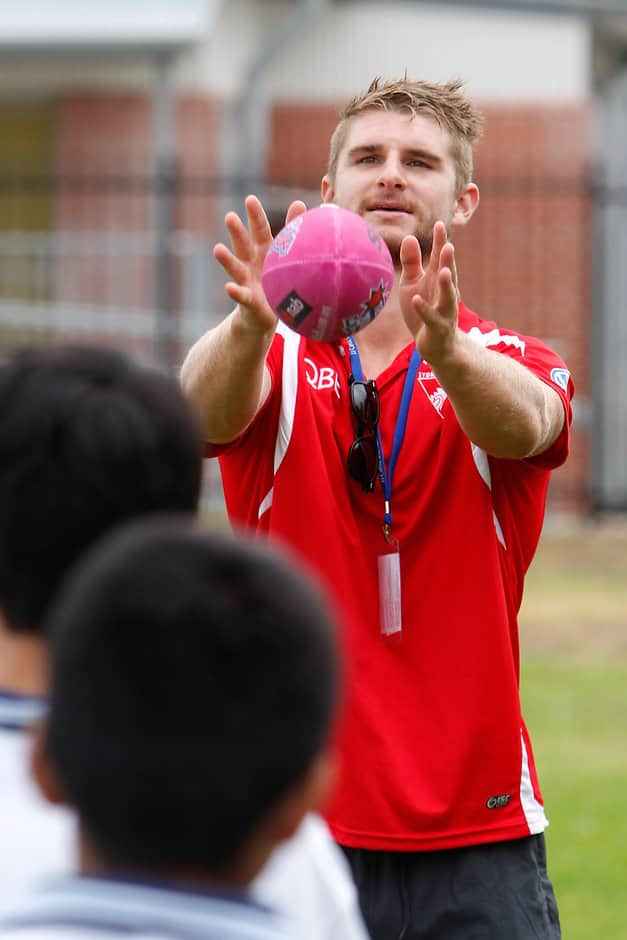 Harry Marsh of the Swans catches a pass from students during the Australia Post Sydney Swans Community Camp in Sydney on February 11, 2014. (Photo: Anthony Pearse/AFL Media)