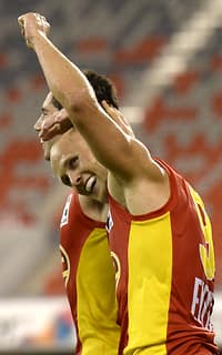 Gary Ablett celebrates Gold Coast's last-gasp NAB Challenge victory against Essendon