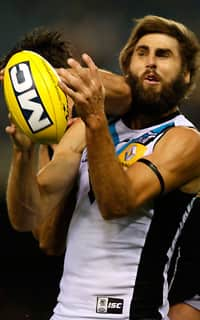 Andrew Walker collects Justin Westhoff high during Port's win against Carlton