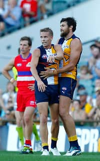 Mark LeCras and Josh Kennedy celebrate an early goal during the Eagles' big win over the Bulldogs