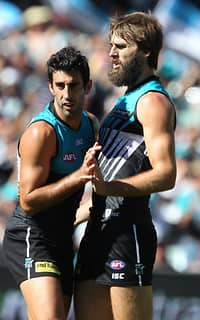 Dom Cassisi and Justin Westhoff celebrate a goal during the Power's win over the Lions