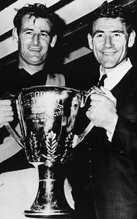 Team captain Fred Swift and coach Tom Hafey of the Richmond Tigers hold up the Premiership Cup after winning the 1967 VFL Grand Final.