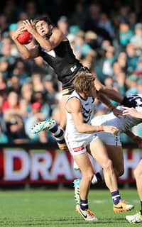 Port hero Chad Wingard soars over the top of a pack to take a sensational mark against Freo