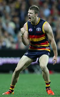 Josh Jenkins celebrates one of his four goals against Collingwood on Thursday night