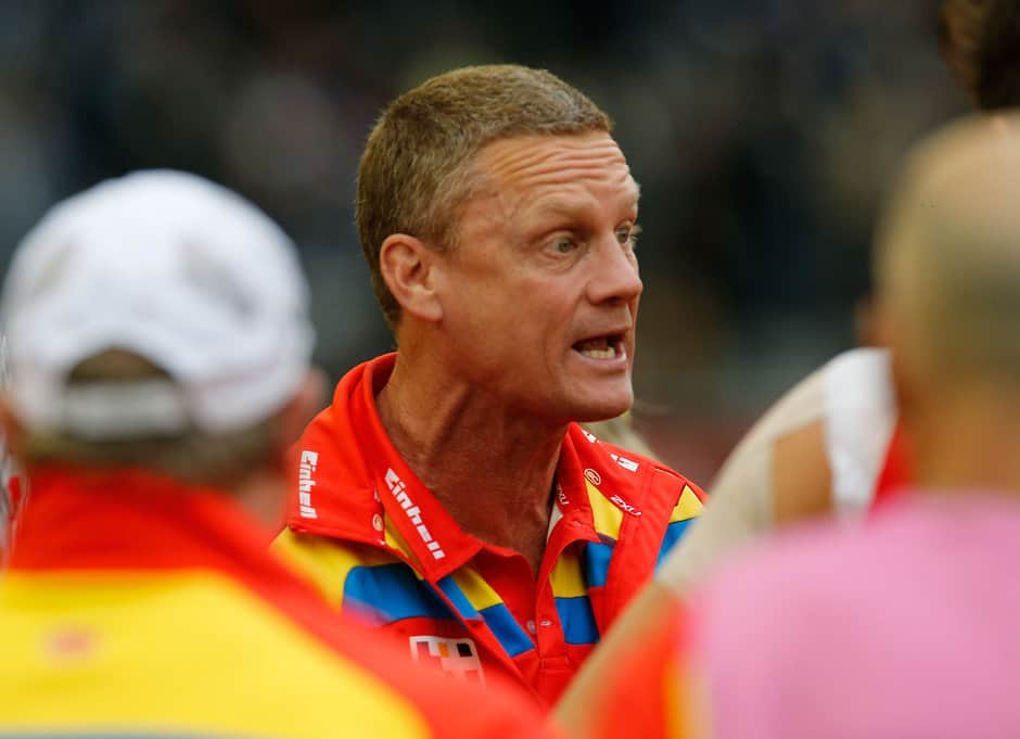 Gold Coast Suns coach Guy McKenna addresses his players during the 2014 AFL Round 20 match between the Carlton Blues and the Gold Coast Suns at Etihad Stadium, Melbourne on August 09, 2014. (Photo: Greg Ford/AFL Media)