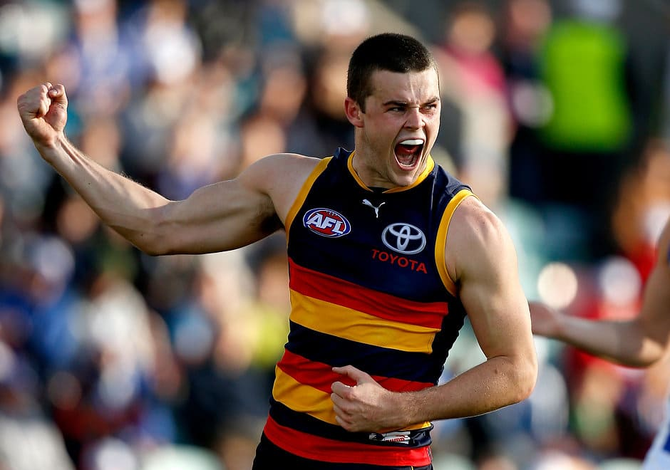 Brad Crouch of the Crows celebrates a goal during the 2014 AFL Round 22 match between the North Melbourne Kangaroos and the Adelaide Crows at Blundstone Arena, Hobart on August 23, 2014. (Photo: Justine Walker/AFL Media)