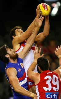 Kurt Tippett clunks a contested mark during the Swans' win over the Dogs
