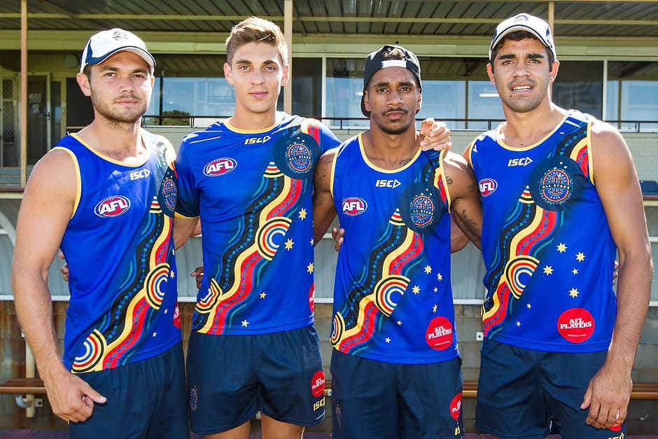 Jarrod Harbrow, Sean Lemmens, Jarrod Garlett, Jack Martin pose in their team shirts during the All Stars clinic and training at Medibank Stadium, Leederville on February 19, 2015. (Photo: Will Russell/AFL Media)