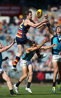 Patrick Dangerfield flies high for a mark over Kane Mitchell