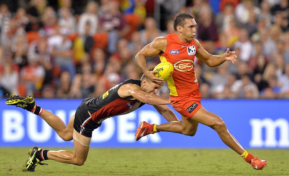 Harley Bennell of the Suns and Sean Dempster of the Saints compete for the ball during the 2015 AFL Round 02 match between the Gold Coast Suns and the St Kilda Saints at Metricon Stadium, Gold Coast on April 11, 2015. (Photo: Bradley Kanaris/AFL Media)