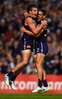 Nick Suban and Michael Walters celebrate a goal as the Dockers sneak past the Swans