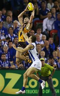 Jack Gunston flies high over Shaun Atley