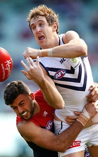 Fremantle's Michael Barlow is tackled by Demon Christian Salem