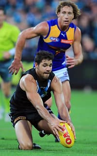 Patrick Ryder of the Power dives on the ball in front of Matt Priddis of the Eagles during the 2015 AFL Round 06 match between Port Adelaide Power and the West Coast Eagles at Adelaide Oval, Adelaide on May 10, 2015. (Photo: James Elsby/AFL Media)