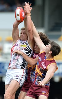 Nick Riewoldt and Marco Paparone fly for a mark at the Gabba