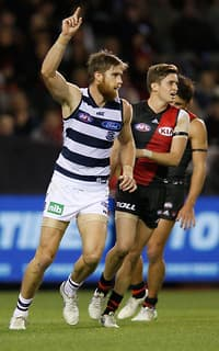 Tom Lonergan celebrates a goal during the Cats thumping win over the Bombers