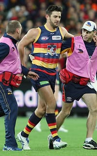 ADELAIDE, AUSTRALIA - JUNE 18: Taylor Walker of the Crows assisted by trainers as he leaves the ground injured during the 2015 AFL round twelve match between the Adelaide Crows and the Hawthorn Hawks at the Adelaide Oval, Adelaide on June 18, 2015. (Photo by AFL Media)