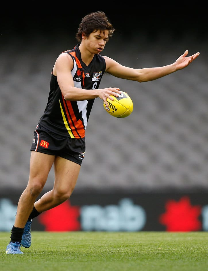 MELBOURNE, AUSTRALIA - JULY 1: Daniel Rioli of Northern Territory kicks the ball during the 2015 AFL Under 18 match between Northern Territory and Tasmania at Etihad Stadium, Melbourne, Australia on July 1, 2015. (Photo by Adam Trafford/AFL Media)