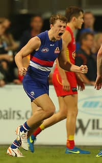 Jack Macrae celebrates a final-term goal in the Western Bulldogs' win over Gold Coast