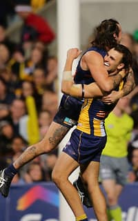 West Coast's Chris Masten celebrates a goal on Saturday night