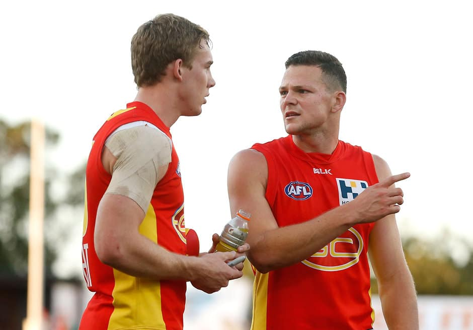 GOLD COAST, AUSTRALIA - JULY 18: Tom Lynch (left) and Steven May of the Suns share a discussion after the 2015 AFL round 16 match between the Gold Coast Suns and the GWS Giants at Metricon Stadium, Gold Coast, Australia on July 18, 2015. (Photo by Michael Willson/AFL Media)