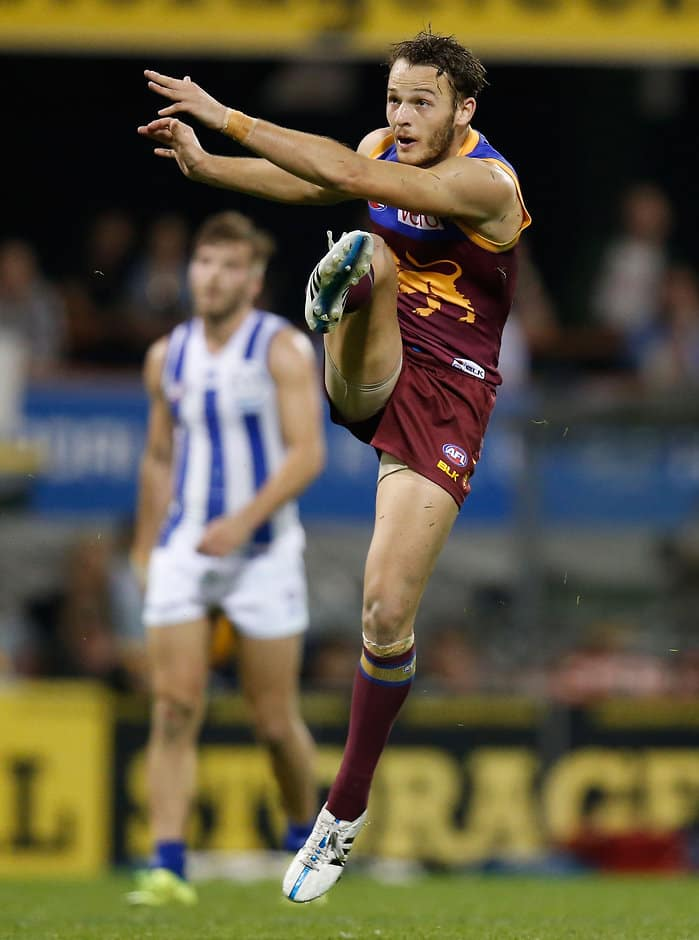 BRISBANE, AUSTRALIA - JULY 25: James Aish of the Lions kicks the ball during the 2015 AFL round 17 match between the Brisbane Lions and the North Melbourne Kangaroos at The Gabba, Brisbane, Australia on July 25, 2015. (Photo by Michael Willson/AFL Media)