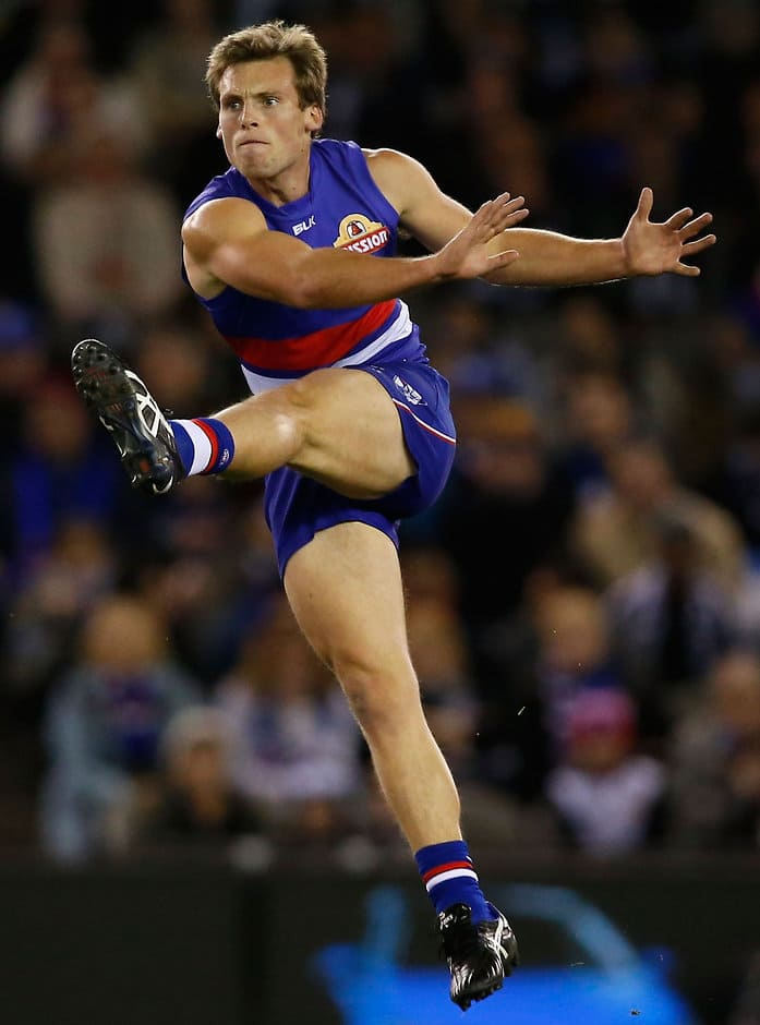 MELBOURNE, AUSTRALIA - JULY 26: Josh Prudden of the Bulldogs kicks the ball during the 2015 AFL round 17 match between the Western Bulldogs and the Collingwood Magpies at Etihad Stadium, Melbourne, Australia on July 26, 2015. (Photo by Adam Trafford/AFL Media)