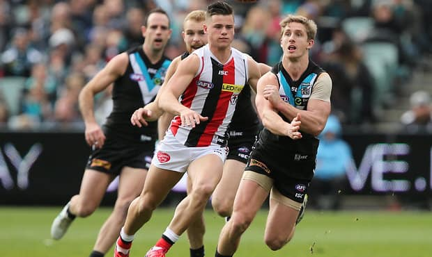 Jack Sinclair chases Hamish Hartlett in round 18 this year.