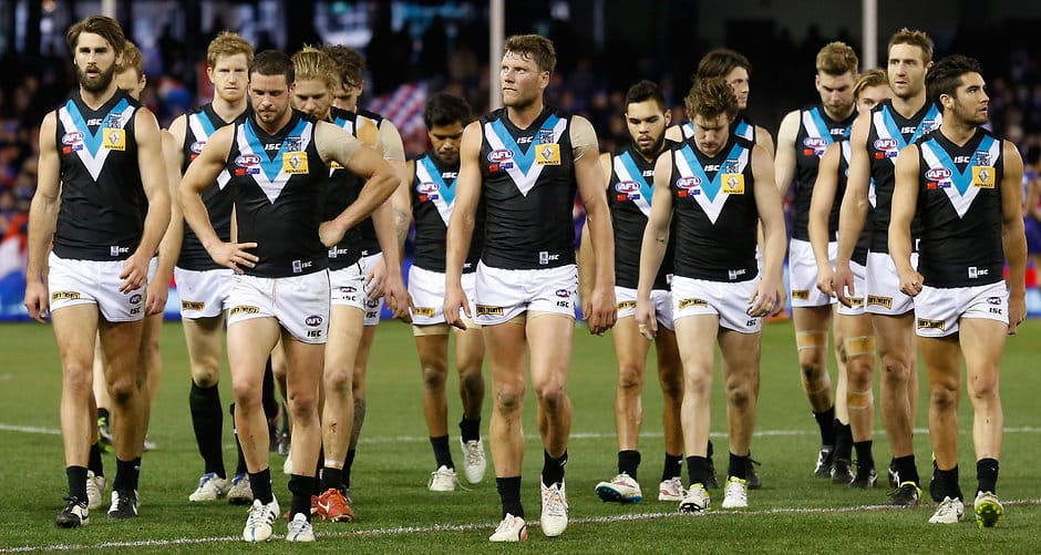 MELBOURNE, AUSTRALIA - AUGUST 8: The Power look dejected after a loss during the 2015 AFL round 19 match between the Western Bulldogs and Port Adelaide Power at Etihad Stadium, Melbourne, Australia on August 8, 2015. (Photo by Michael Willson/AFL Media)