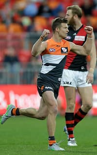 Rhys Palmer celebrates a goal as the Giants pull away from the Bombers