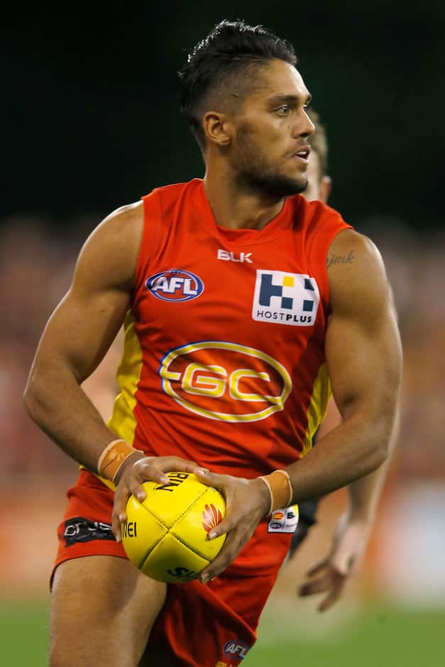 GOLD COAST, AUSTRALIA - AUGUST 22: Aaron Hall of the Suns in action during the 2015 AFL round 21 match between the Gold Coast Suns and the Essendon Bombers at Metricon Stadium, Gold Coast, Australia on August 22, 2015. (Photo by Darrian Traynor/AFL Media)