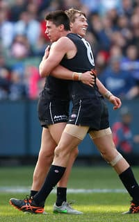 Matthew Kreuzer and Patrick Cripps celebrate a goal against the Demons