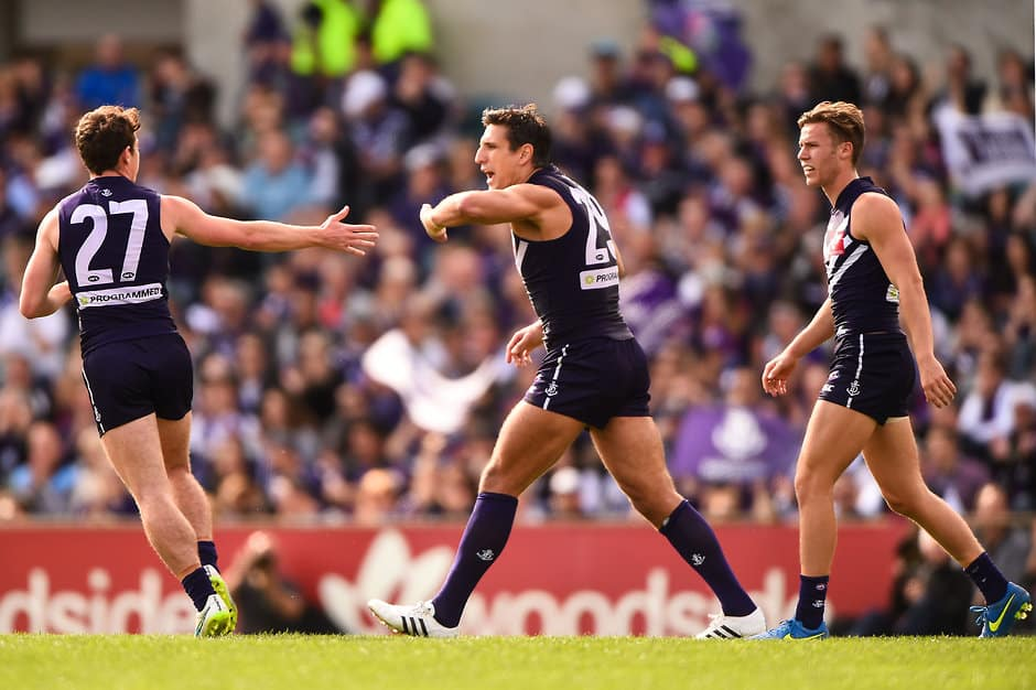 PERTH, AUSTRALIA - AUGUST 30: Matthew Pavlich and Lachie Neale of the Fremantle Dockers celebrates a goal during the 2015 AFL round 22 match between the Fremantle Dockers and the Melbourne Demons at Domain Stadium, Perth, Australia on August 30, 2015. (Photo by Daniel Carson/AFL Media)
