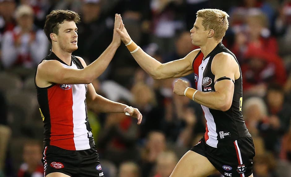 MELBOURNE, AUSTRALIA - AUGUST 30: Dylan Roberton (left) and Nick Riewoldt of the Saints celebrate during the 2015 AFL round 22 match between the St Kilda Saints and the Sydney Swans at Etihad Stadium, Melbourne, Australia on August 30, 2015. (Photo by Adam Trafford/AFL Media)