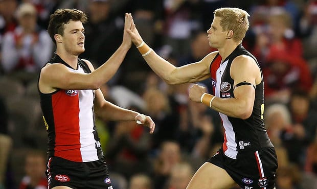 Dylan Roberton and Nick Riewoldt celebrate a goal.