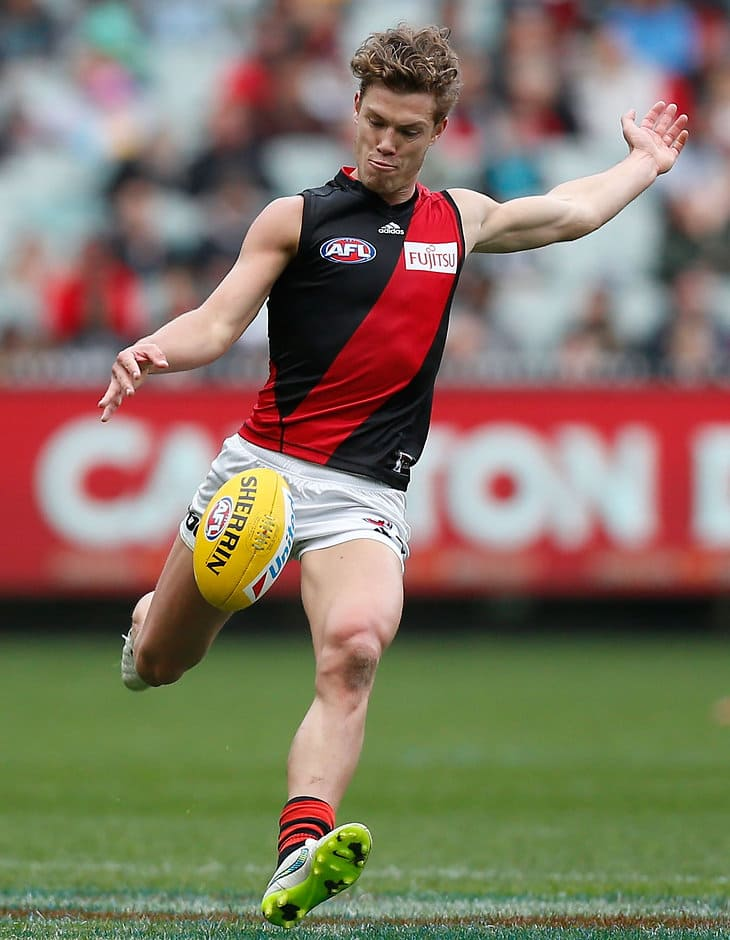 MELBOURNE, AUSTRALIA - SEPTEMBER 6: Jake Melksham of the Bombers kicks the ball during the 2015 AFL round 23 match between the Collingwood Magpies and the Essendon Bombers at the Melbourne Cricket Ground, Melbourne, Australia on September 6, 2015. (Photo by Adam Trafford/AFL Media)