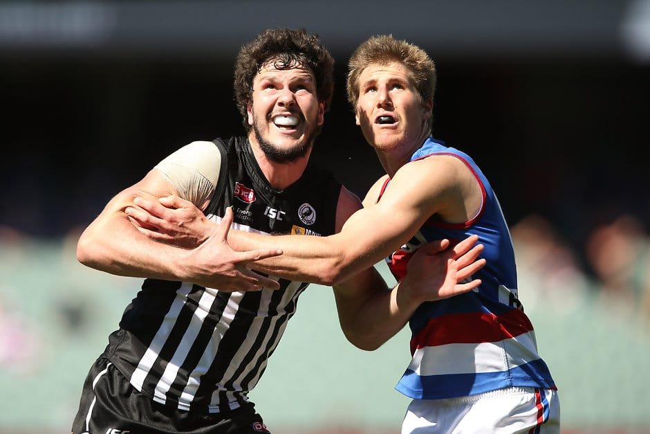 ADELAIDE, AUSTRALIA - SEPTEMBER 13: Jarrad Redden of the Magpies competes with Jesse Kemp of the Bulldogs during the 2015 SANFL 1st Semi Final match between the Port Adelaide Magpies and Central District at Adelaide Oval, Adelaide on September 13, 2015. (Photo by James Elsby/AFL Media)