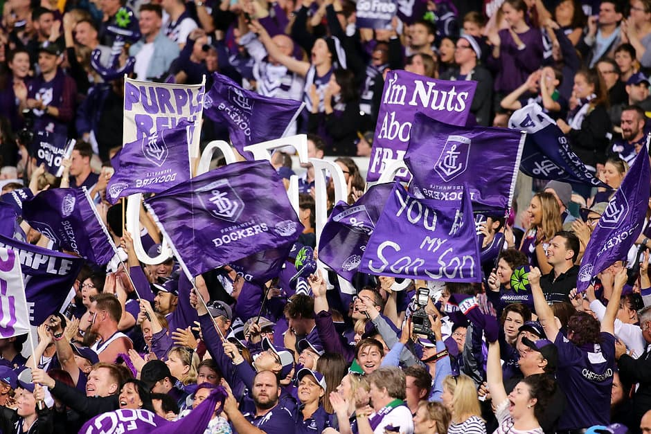 PERTH, AUSTRALIA - SEPTEMBER 25: Fremantle fans celebrate after a goal is scored during the 2015 AFL First Preliminary Final match between the Fremantle Dockers and the Hawthorn Hawks at Domain Stadium, Perth, Australia on September 25, 2015. (Photo by Will Russell/AFL Media)