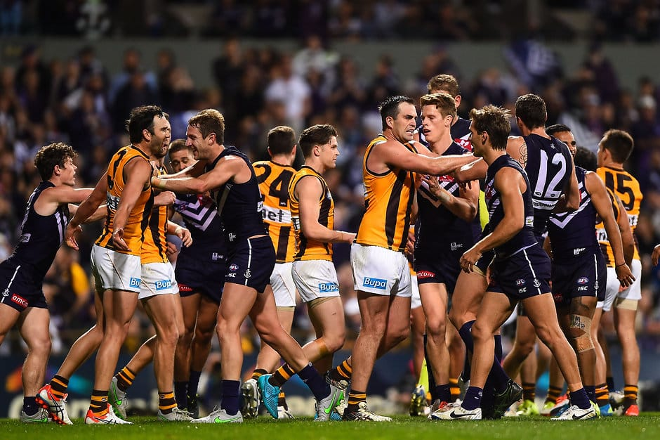 PERTH, AUSTRALIA - SEPTEMBER 25: Brian Lake of the Hawthorn Hawks shoves Jonathon Griffin of the Fremantle Dockers during the 2015 AFL First Preliminary Final match between the Fremantle Dockers and the Hawthorn Hawks at Domain Stadium, Perth, Australia on September 25, 2015. (Photo by Daniel Carson/AFL Media)