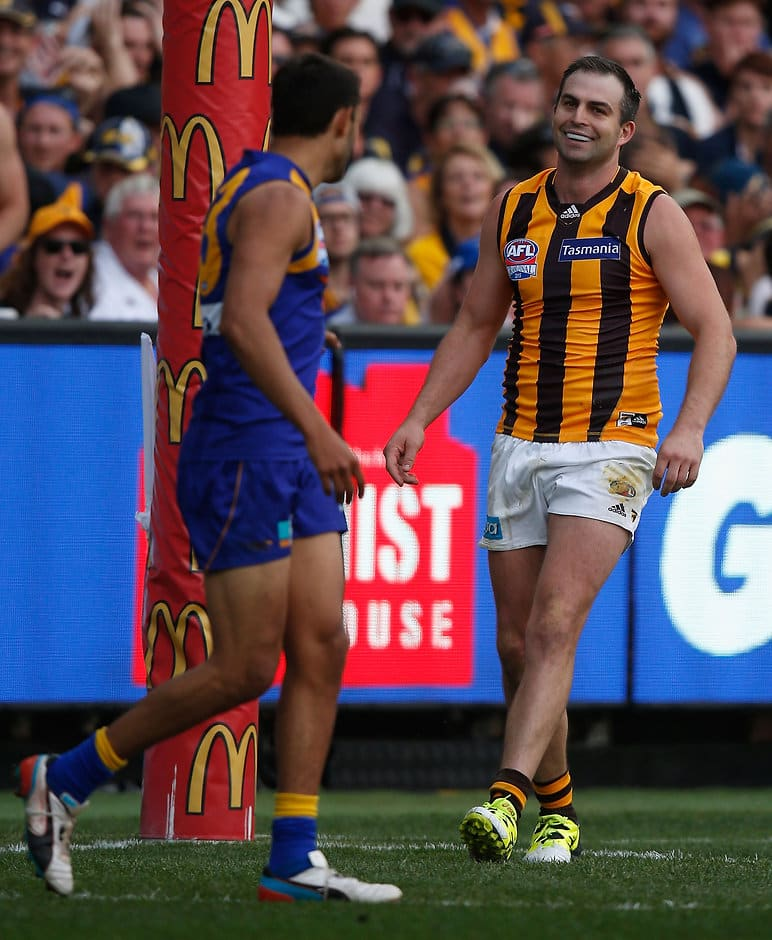 MELBOURNE, AUSTRALIA - OCTOBER 3: Josh Hill of the Eagles kick for goal is touched by Brian Lake of the Hawks  during the 2015 Toyota AFL Grand Final match between the Hawthorn Hawks and the West Coast Eagles at the Melbourne Cricket Ground, Melbourne, Australia on October 3, 2015. (Photo by Sean Garnsworthy/AFL Media)