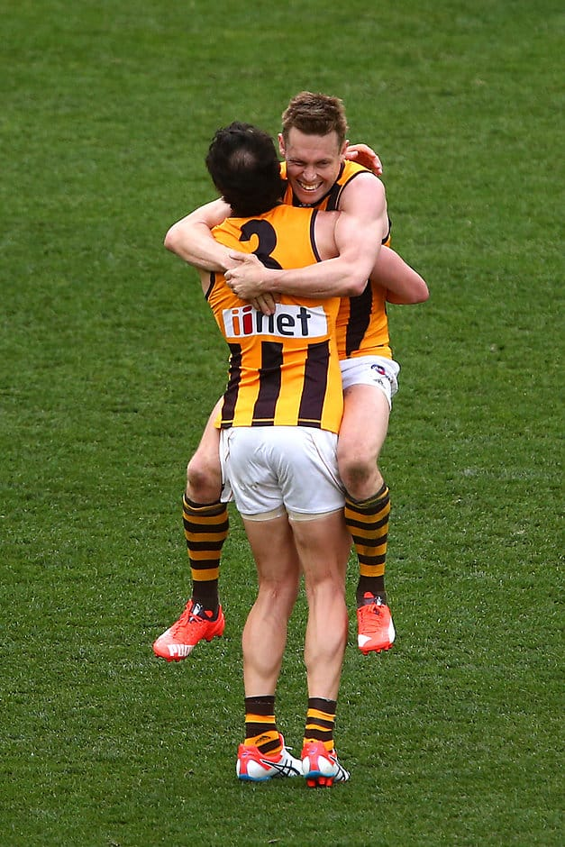 MELBOURNE, AUSTRALIA - OCTOBER 3: Sam Mitchell celebrates with team-mate Jordan Lewis of the Hawks after a win during the 2015 Toyota AFL Grand Final match between the Hawthorn Hawks and the West Coast Eagles at the Melbourne Cricket Ground, Melbourne, Australia on October 3, 2015. (Photo by Rob Prezioso/AFL Media)