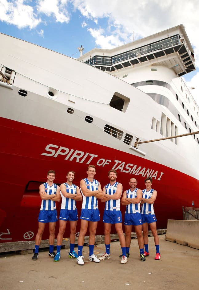 North Melbourne players in front of the Spirit of Tasmania - ${keywords}