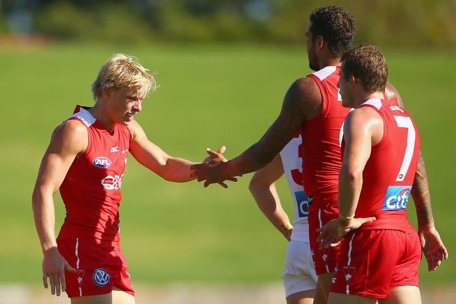 SYDNEY, AUSTRALIA - FEBRUARY 12:  Isaac Heeney and Lance Franklin of the Red Team celebrate a goal during the Sydney Swans AFL intra-club match at Henson Park on February 12, 2016 in Sydney, Australia.  (Photo by Mark Kolbe/Getty Images/AFL Media)