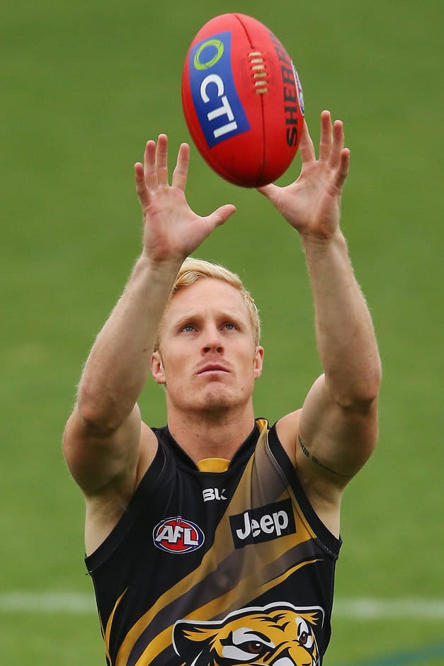 MELBOURNE, AUSTRALIA - FEBRUARY 17:  Steven Morris of the Tigers marks the ball during a Richmond Tigers AFL media session at Punt Road Oval on February 17, 2016 in Melbourne, Australia.  (Photo by Michael Dodge/Getty Images/AFL Media)