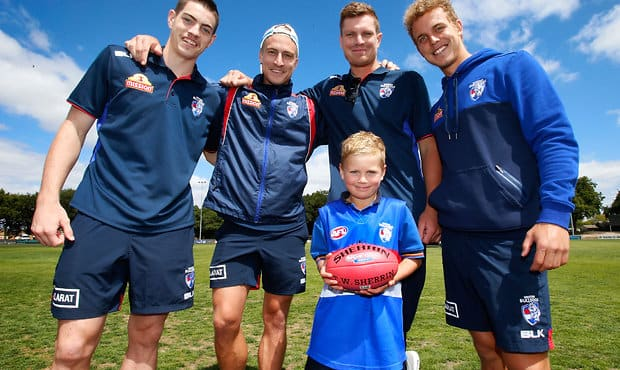 BALLARAT, AUSTRALIA - FEBRUARY 16: (L-R) Brad Lynch, Shane Biggs, Jack Redpath and Mitch Wallis of the Bulldogs pose for a photograph during the Western Bulldogs Community Camp clinic for Pleasant Street Primary School students at the City Oval in Ballarat, Australia on February 16, 2016. (Photo by Adam Trafford/AFL Media)